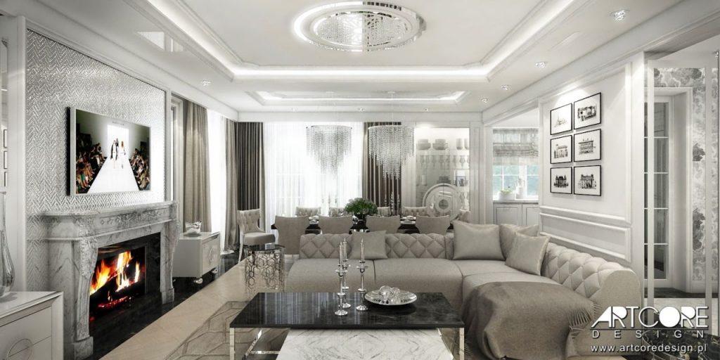 stylowy salon z kominkiem portalowym pikowana sofa glamour